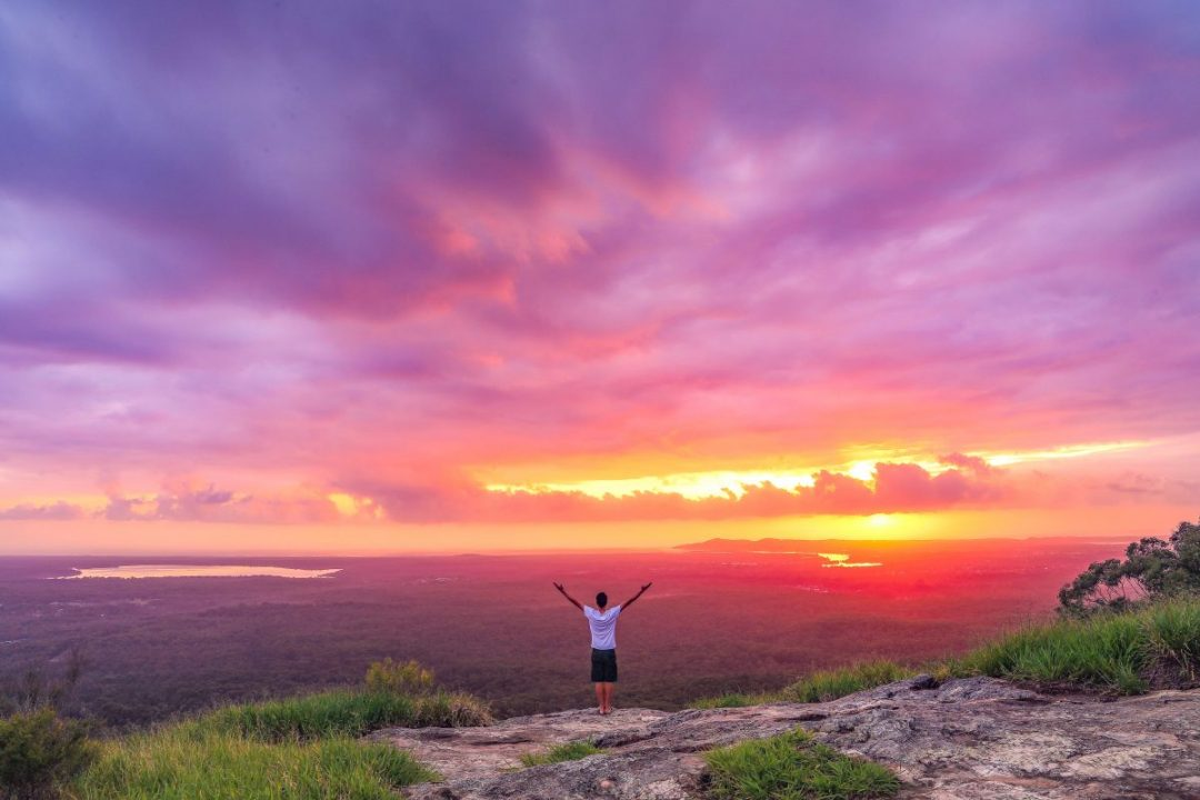 Sunrise salute from the top of Mt Tinbeerwah. (Photo: Clinton Blair)